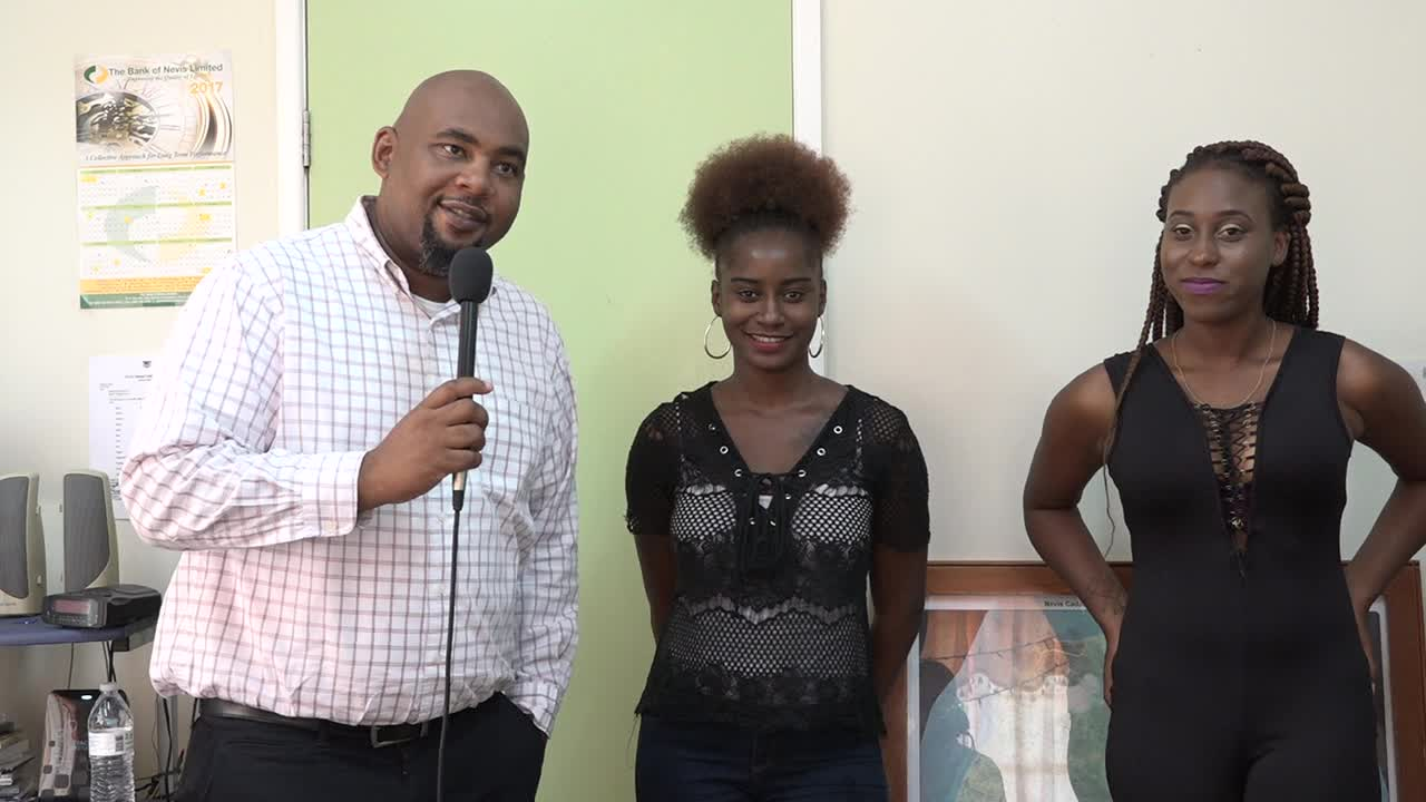 (l-r) Mr. Huey Sargeant, Assistant Secretary in the Ministry of Agriculture introducing Hydeia Tyson and Jonieka Smithen, the most recent recipients from Nevis who will be pursuing studies at Earth University in Costa Rica in September, at an announcement ceremony at the ministry on August 18, 2017